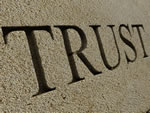 Image of trust engraved in stone.